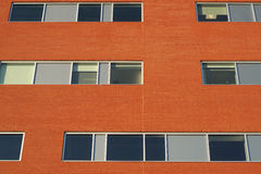 Red brick wall office building windows business facade Royalty Free Stock Photo
