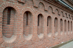Red brick wall of the old building in St. Petersburg Stock Image