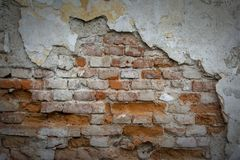 Red brick wall with old falling plaster. Background royalty free stock photography