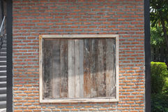 Red brick wall and Old wood window , Concept design , loft Royalty Free Stock Photography