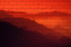 Red brick wall over landscape. Red brick wall over mountainous landscape with bubbled effect Stock Photography