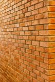 Red brick wall perspective view of empty brick wall textured background Royalty Free Stock Photo