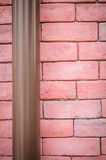 Red brick wall with pipe Royalty Free Stock Image
