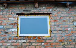 Red brick wall with plastic window Stock Images