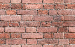 Red brick wall, seamless background. Old weathered red brick wall, seamless background photo texture Royalty Free Stock Photos