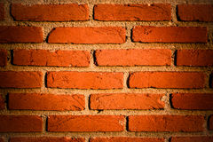 Red brick wall segment with yellow/reddish junctions Royalty Free Stock Photos