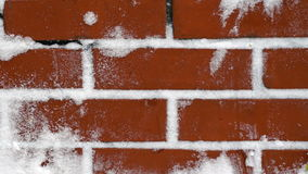 Red brick wall with snow stock video footage