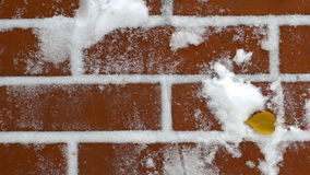 Red brick wall with snow stock footage