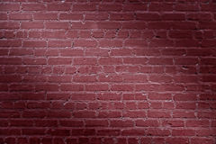 Red Brick Wall Spotlight Background. Closeup of light brick wall background Stock Image