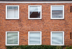 Red brick wall with square windows Royalty Free Stock Images