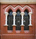 Red brick wall and stained glass window in Holy trinity Cathedral in Yangon, Myanmar, Burma.  Stock Photography