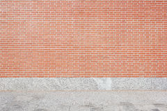 Red brick wall and stone tiled floor background Stock Image