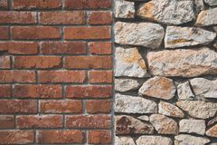 Red brick wall and stone wall background Royalty Free Stock Photos