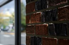 Red brick wall and tall window Royalty Free Stock Photo