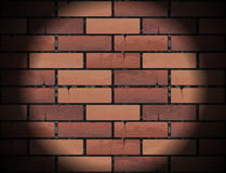 Red brick wall texture background with round light beam. Projector spotlight circle. Vector illustration Royalty Free Stock Image