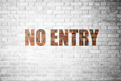 Red Brick wall texture with a word No Entry Royalty Free Stock Photos
