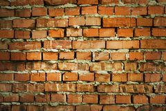 Red brick wall texture grunge background with vignetted corners, may use to interior design Stock Photography