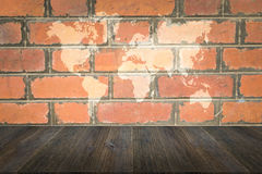 Red Brick wall texture surface with Wood terrace and world map Stock Photo