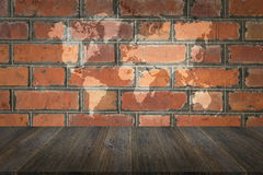 Red Brick wall texture surface with Wood terrace and world map Royalty Free Stock Images
