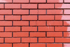 Red Brick Wall Texture. Texture of unevenly painted red brick wall with a vertical crack stock image