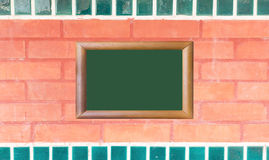 Red brick wall texture with wood image frame Stock Photography