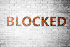 Red Brick wall texture with a word Blocked Stock Photography
