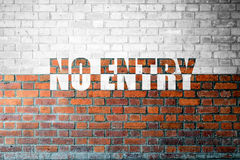 Red Brick wall texture with a word No Entry Royalty Free Stock Photography