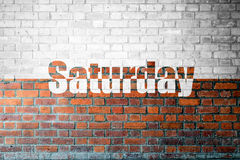 Red Brick wall texture with a word Saturday Stock Image