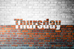 Red Brick wall texture with a word Thursday Royalty Free Stock Photos