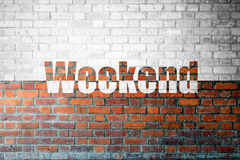 Red Brick wall texture with a word Weekend Royalty Free Stock Images