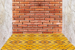 Red brick wall texture and yellow mosaic Stock Images