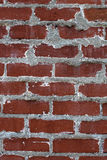 Red Brick Wall. Textured brick background in red Royalty Free Stock Photography
