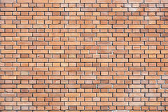 Red brick wall - textured background Royalty Free Stock Photography