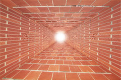 Red Brick wall tunnel with light. Abstract for designer Stock Photo