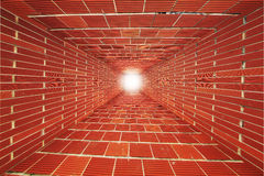 Red Brick wall tunnel with light Royalty Free Stock Photography