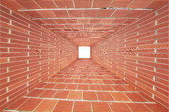 Red Brick wall tunnel with light Royalty Free Stock Images