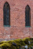 Red brick wall with two vertical windows stock photos