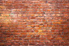 Red brick wall, urban exterior, ancient weathered surface Royalty Free Stock Image