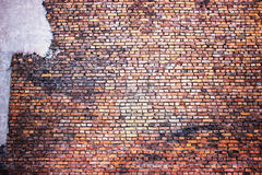 Red brick wall, urban exterior, ancient weathered surface Stock Photography