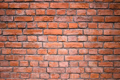 Red brick wall, urban exterior weathered surface as background Royalty Free Stock Photo