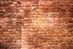 Red brick wall, urban exterior weathered surface as background Stock Photo
