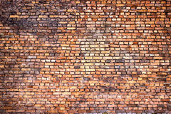 Red brick wall, urban exterior weathered surface as background Royalty Free Stock Photos