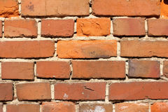 Red brick wall. Very old red bricks in the oldness of the masonry of the old house Stock Photos