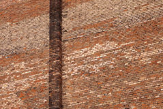 Red brick wall. Weathered texture of red brick wall for background Stock Photo