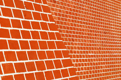 Red brick wall with white seams. Side view Royalty Free Stock Images
