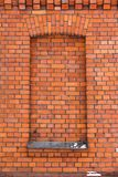 Red brick wall and a window stock photography