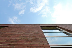 Red brick wall and window in sky. Red brick wall with corners and lines with window in sky Royalty Free Stock Photo
