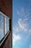 Red brick wall and window in sky Stock Images