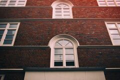 Red brick wall with windows Royalty Free Stock Photos