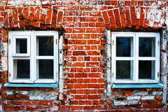 Red brick wall with windows. Red brick wall. Day. Windows Stock Image